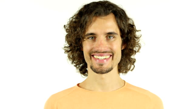 Portrait of mid adult man smiling against white background video