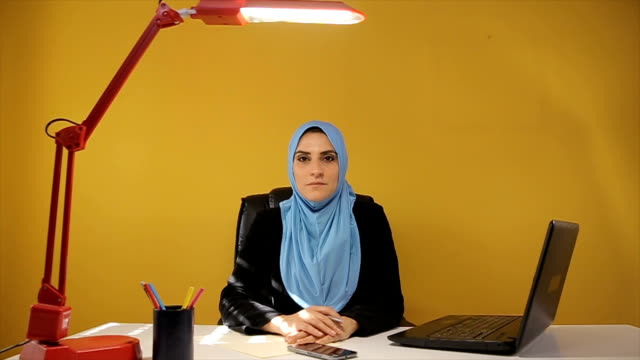 Portrait of modern muslim businesswoman in the office video