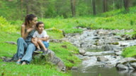 Portrait of mother with her son near a stream video