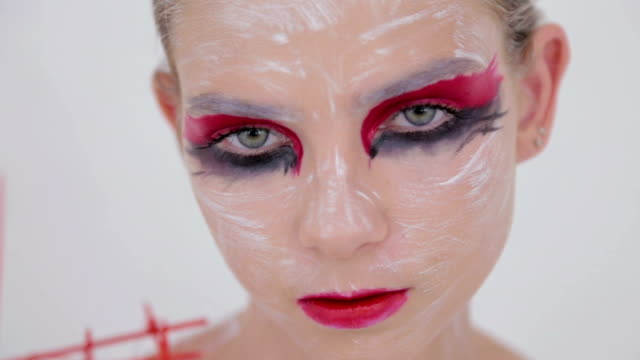 Portrait of mysterious girl with creative make-up and elegant hairstyle video