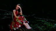Portrait of mysterious girl with creative make-up in ethnic red dress video