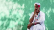 Portrait of old black cuban woman smoking cigar video