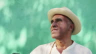 Portrait of old cuban man with straw hat smiling video