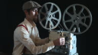 Portrait Of Old Fashioned Cinema Projectionist Starting New Film video