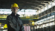 Portrait of Positive and Attractive Technician in Hard Hat in Industrial Environment. video