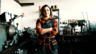 Portrait of pretty female worker in a steel mill video