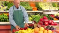 Portrait of produce man working at grocery store video