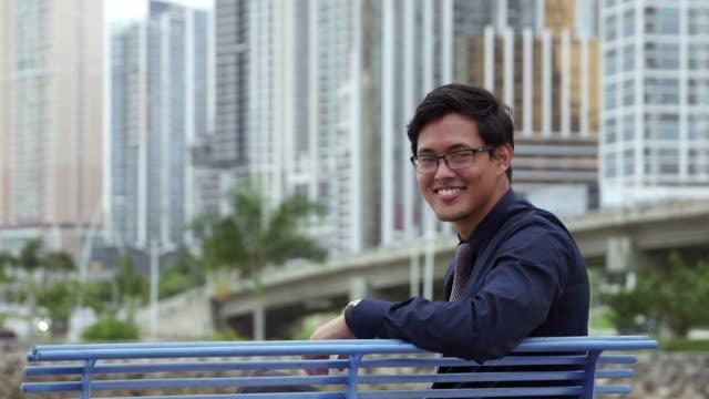 Portrait of proud, happy asian businessman smiling, man, manager video
