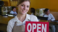 Portrait of restaurant owner with open sign video