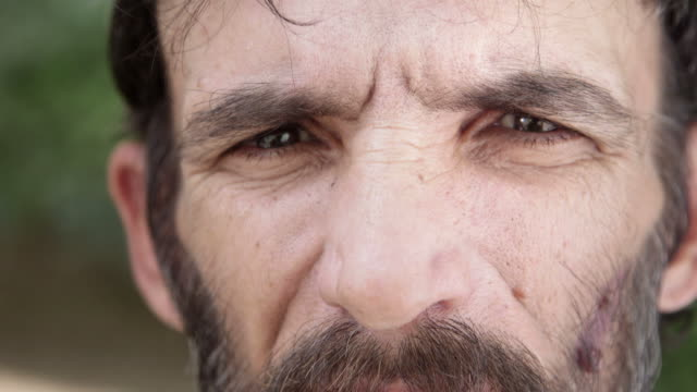 Portrait of sad adult hispanic man with beard, close up video