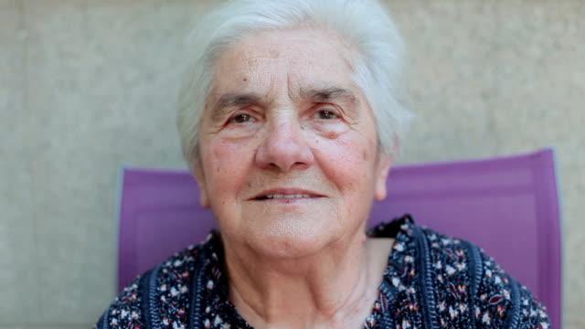 portrait of senior woman sitting outside video