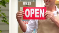 Portrait of small business owner with open sign video