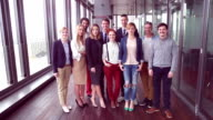 Portrait of smiling business and advertising team video