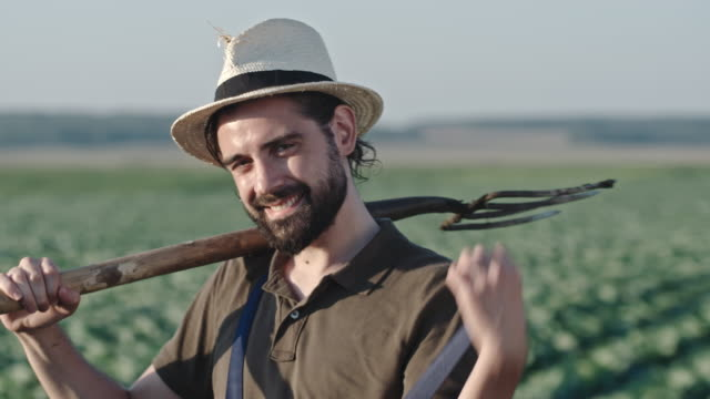 Portrait of Smiling Farmer with Pitchfork video