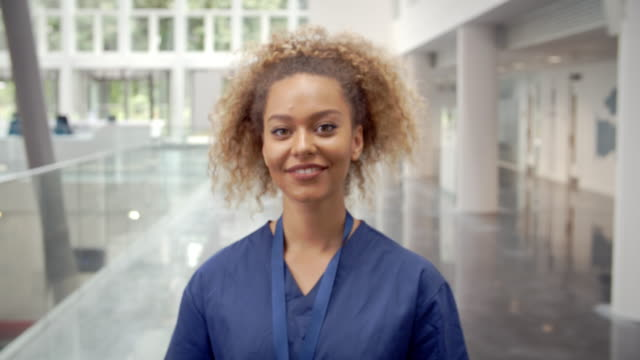 Portrait Of Smiling Female Nurse In Lobby Of Hospital video