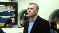 Portrait of teacher in university library video