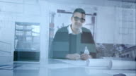 Portrait of the architect through his office glass wall video