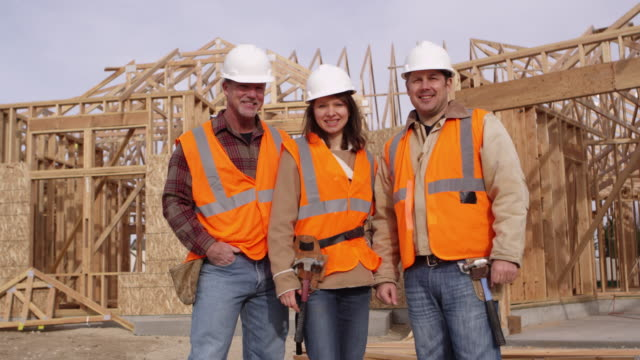 Portrait of three construction workers video