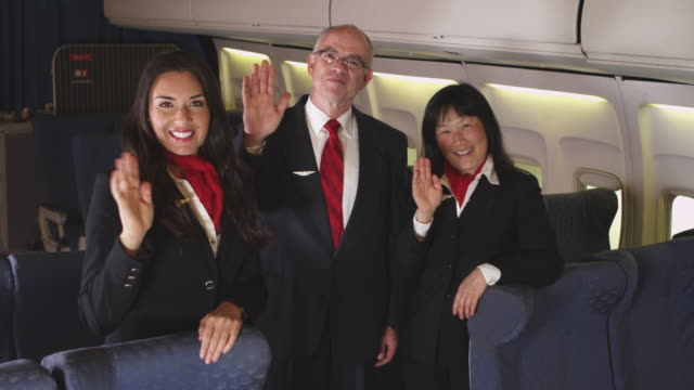 Portrait of three flight attendants video
