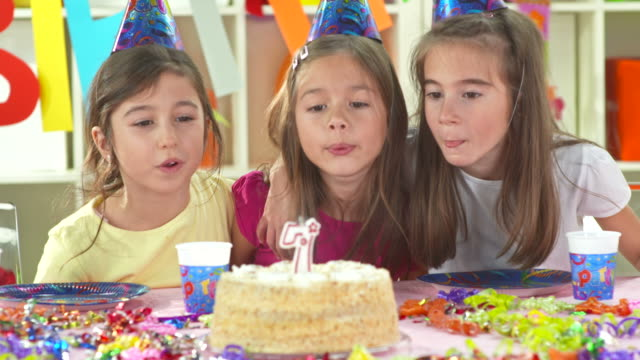 HD: Portrait Of Three Girl Blowing Birthday Candles video