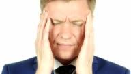Portrait of Tired, Stressful Businessman having a headache video