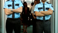 Portrait of two airport security guards video