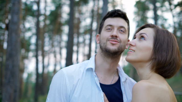 Portrait of two attractive young people, guys and girls in the pine forest video