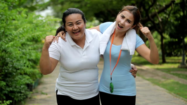Portrait of two fit young women smiling video