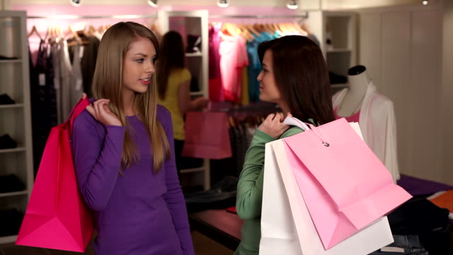 Portrait of two teen shoppers video