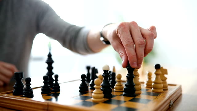 Portrait of two young man playing chess video
