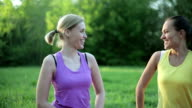 Portrait of two young women flexing her biceps video