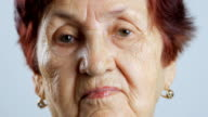 Portrait of very old woman, closeup view isolated on white video