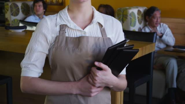 Portrait of waitress at restaurant video