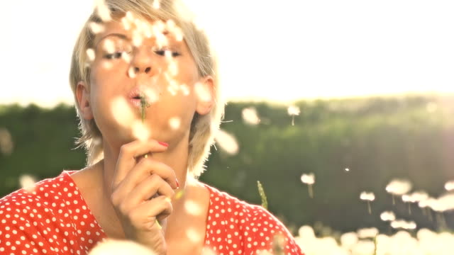 HD SUPER SLOW MO: Portrait Of Woman Blowing Dandelion video