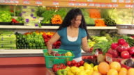 Portrait of woman in shopping for produce video