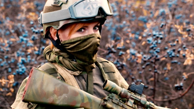 Portrait of woman soldier with a weapon video