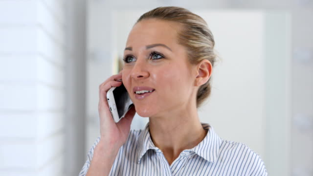 Portrait of Woman Talking on Phone video