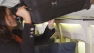Portrait of woman traveling with luggage video