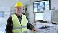 DS portrait of worker in recycling facility control center video