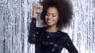 Portrait of young african american girl with afro and glamour make up. video