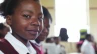 Portrait of young African school girl video