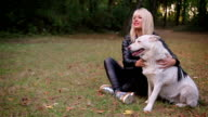 portrait of young  blonde woman with  dog video