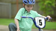 Portrait of young boy with bicycle video