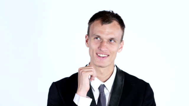 Portrait of young businessman thinking video