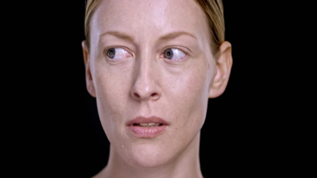 Portrait of young Caucasian woman moving her eyes around video