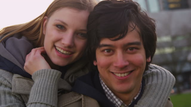 Portrait of young couple at city park, slow motion video