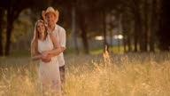 SLO MO Portrait of young couple in the meadow video