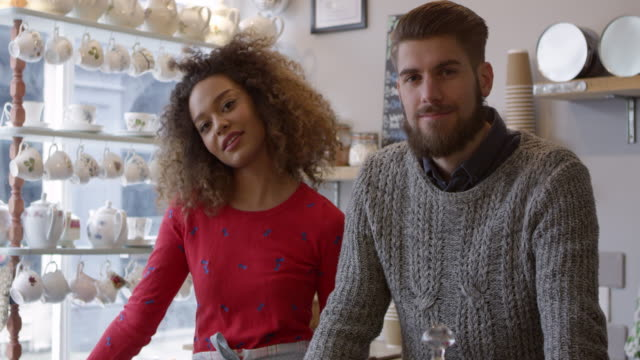 Portrait Of Young Couple Working In Coffee Shop Shot On R3D video