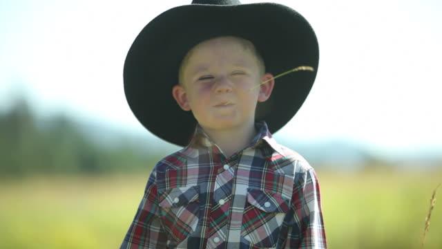 Portrait of young cowboy video