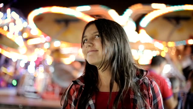 Portrait of young girl in amusement park video